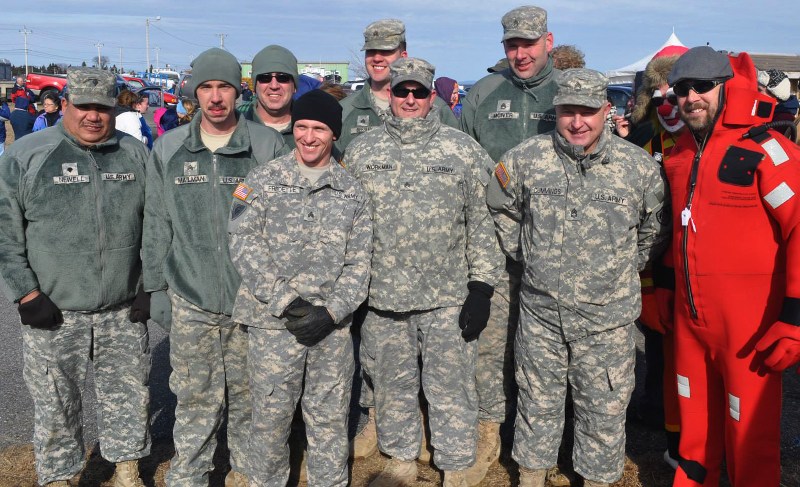 Miliary personnel at the annual polar bear dip pose for a picture.