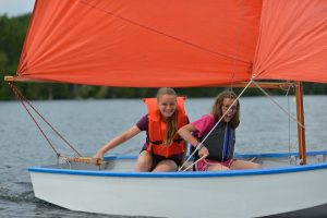 Sailing camp students enjoying a day on the water on Indian Lake