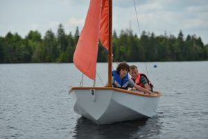 Sailing camp students enjoying a day on the water on Keenes Lake