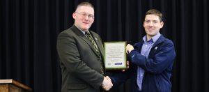 Academic Dean receiving appreciation award from St. Croix Tissue representative