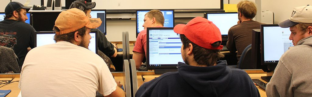 Students using computers to access portal