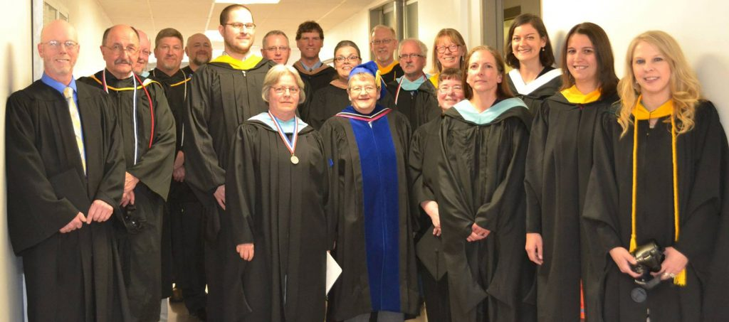 Faculty members in graduation gowns